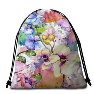 Serviette de plage ronde fleurs aquarelle sac