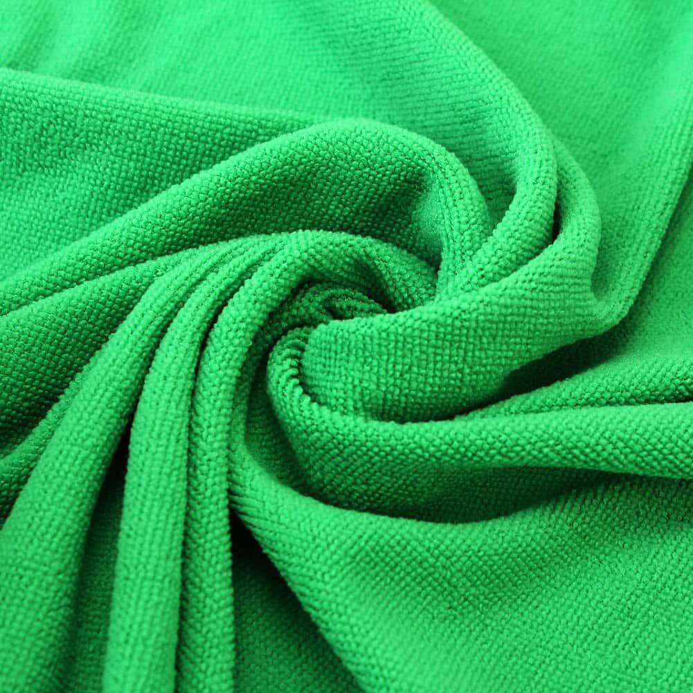 Serviette de plage en fibres absorbantes vert detail